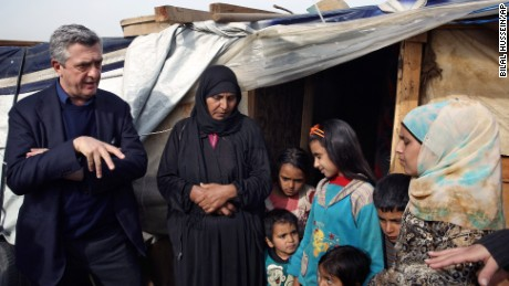 U.N. High Commissioner for Refugees Filippo Grandi speaks with a Syrian family outside their tent in Saadnayel, Lebanon, in the Bekaa Valley, on January 22.