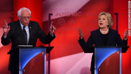 US Democratic presidential candidates Hillary Clinton (R) and Bernie Sanders participate in the MSNBC Democratic Candidates Debate at the University of New Hampshire in Durham on February 4, 2016. 