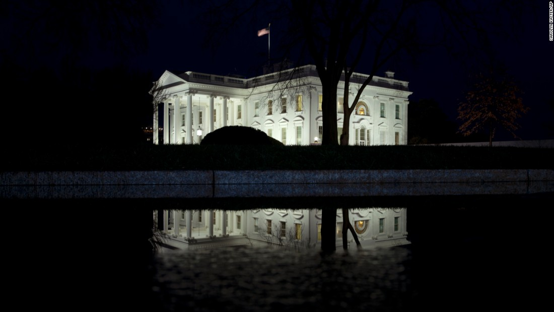 The White House, pictured here on February 3, shines through a wet evening.