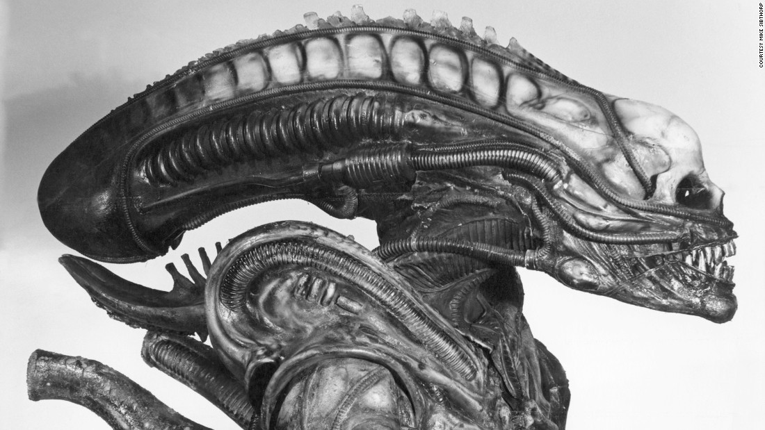 The alien's head, nearly a meter long, was at one point going to be filled with live maggots, says Allder. Whilst he was wearing it Badejo could barely see and had to take it off every 15 minutes to stop himself from overheating.
