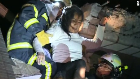 Rescuers searching for victims trapped after quake