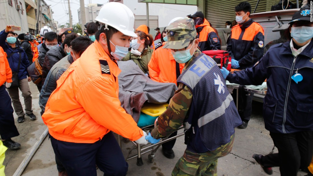 Rescue workers remove a victim on a stretcher in Tainan.