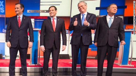 Republican Presidential candidates (L-R) Texas Senator Ted Cruz, Florida Senator Marco Rubio, former Florida Gov. Jeb Bush, and Ohio Gov. John Kasich arrive for the Republican Presidential debate sponsored by Fox News at the Iowa Events Center in Des Moines, Iowa on January 28, 2016.