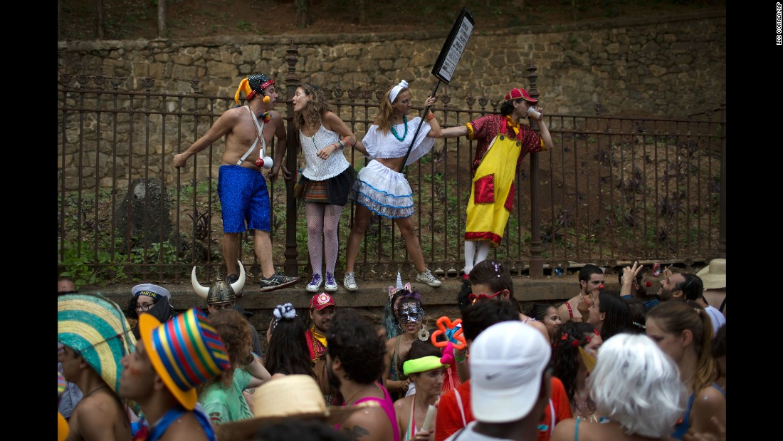 "Revelers enjoy the ""Heaven on Earth"" block party during Carnival celebrations in Rio de Janeiro on February 6."