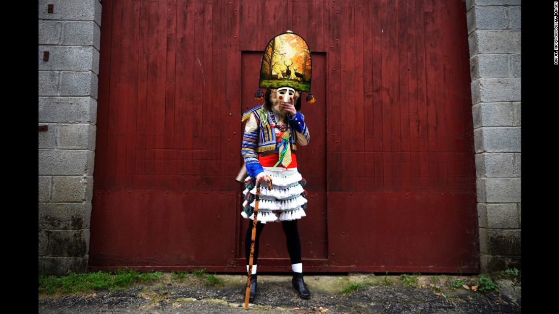 A villager is dressed in costume near Maceda, Spain, on February 6.