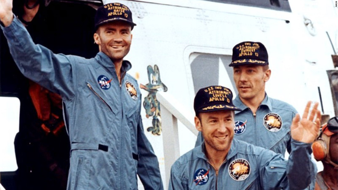 "The crew members of Apollo 13 -- from left, Fred Haise, James Lovell and John Swigert -- are seen after splashdown in April 1970. Apollo 13 was scheduled to be the third lunar landing mission. The crew launched on April 11, 1970, but two days later and about 205,000 miles from Earth, the service module oxygen tank ruptured, crippling the spacecraft. ""Houston, we've had a problem,"" Lovell said. Instead of landing, the crew did a flyby and came home, safely splashing down on April 17. Lovell's book ""Lost Moon"" became the basis for the motion picture ""Apollo 13."""