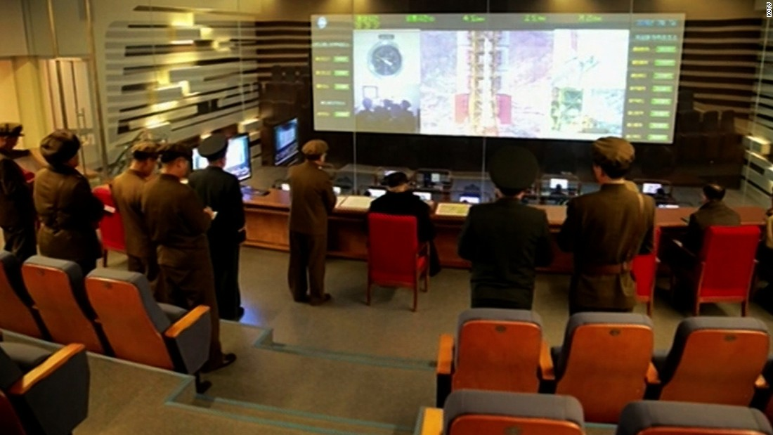 An official photograph shows the control room.
