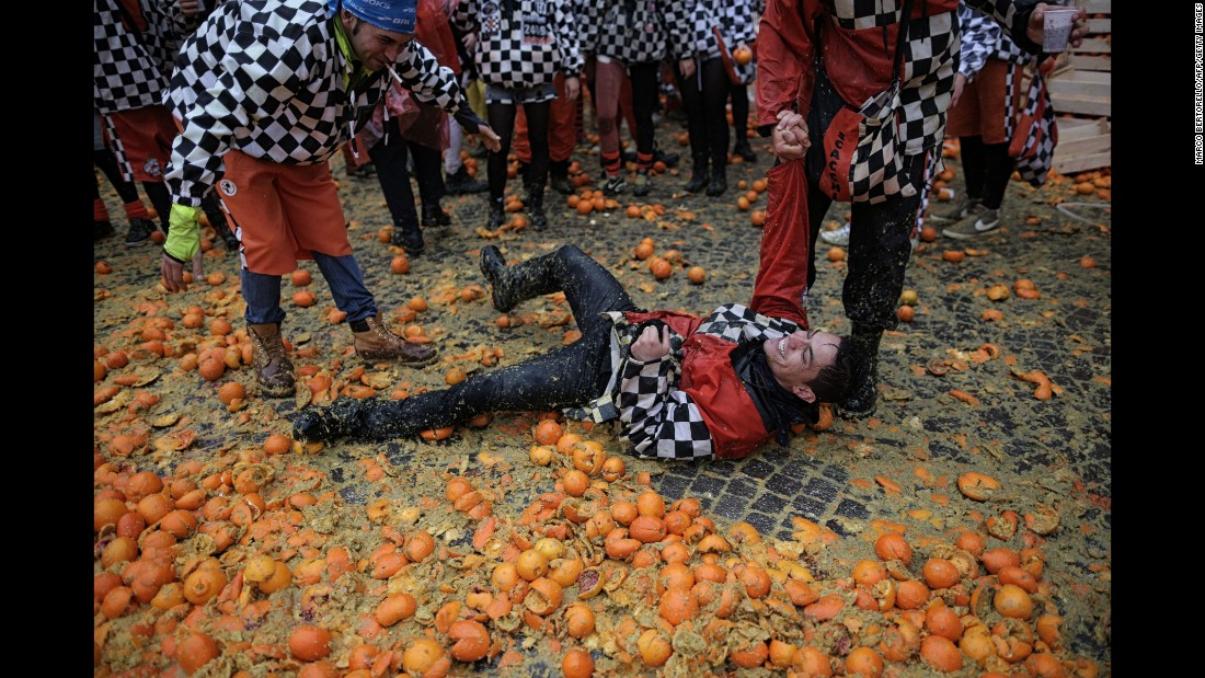 "People in Ivrea, Italy, participate in the traditional ""Battle of the Oranges"" on February 7."