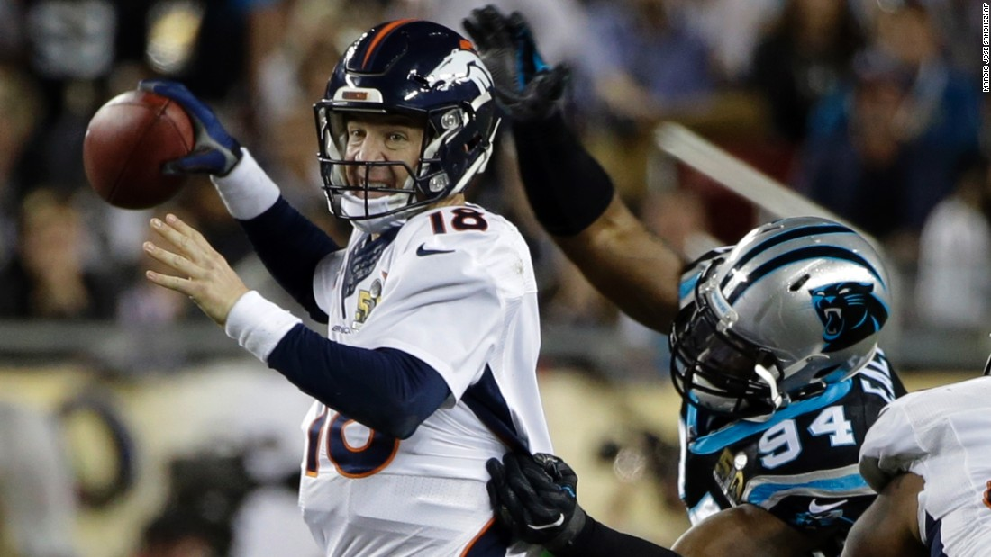 Broncos quarterback Peyton Manning is hit by Carolina's Kony Ealy in the fourth quarter. The hit forced a fumble, and Carolina recovered the ball.