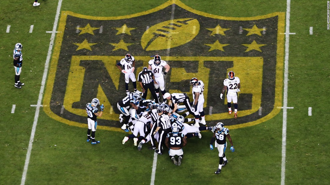 Denver and Carolina players attempt to recover a Manning fumble in the fourth quarter.