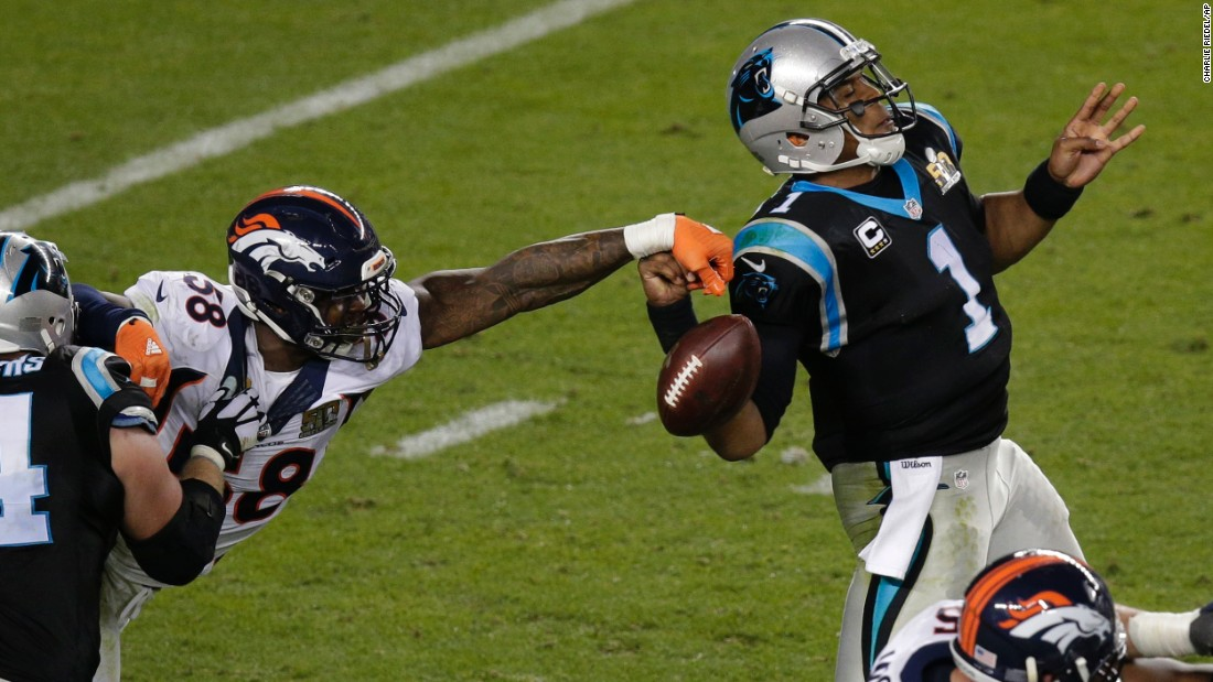 "Miller strips the ball from Newton. He was named the game's <a href=""http://www.cnn.com/2015/01/25/us/gallery/super-bowl-mvps/index.html"" target=""_blank"">Most Valuable Player</a>."
