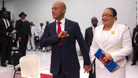 Haiti's President Michel Martelly stands with his wife Sophia before they leave Parliament chambers, in Port-au-Prince, Haiti on Sunday.