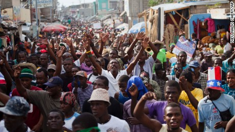 Demonstrators chant anti-government slogans in the capital of Port-au-Prince.