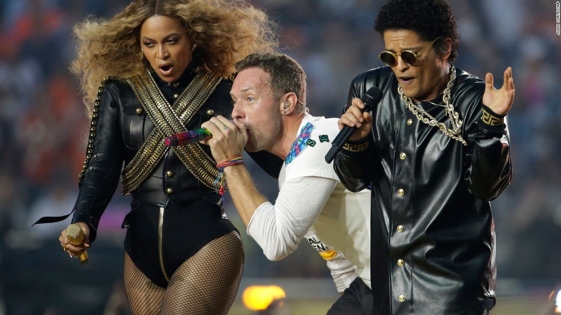Beyoncé performs with Coldplay's Chris Martin and singer Bruno Mars during the Super Bowl 50 halftime show on February 7.