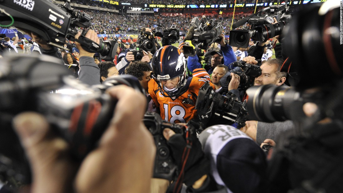 "Manning leaves the field after the Broncos were crushed by Seattle in <a href=""http://www.cnn.com/2014/02/02/worldsport/gallery/super-bowl-denver-seattle/index.html"" target=""_blank"">Super Bowl XLVIII</a> in 2014."