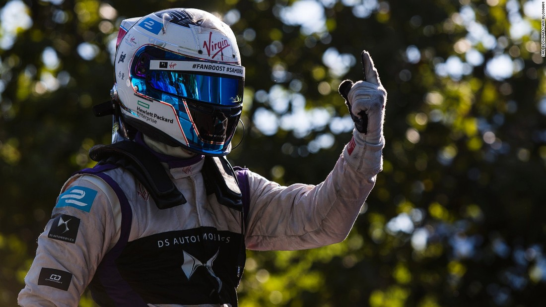 A joyous Sam Bird gives a one-fingered victory salute after the Formula E ePrix in Buenos Aires.