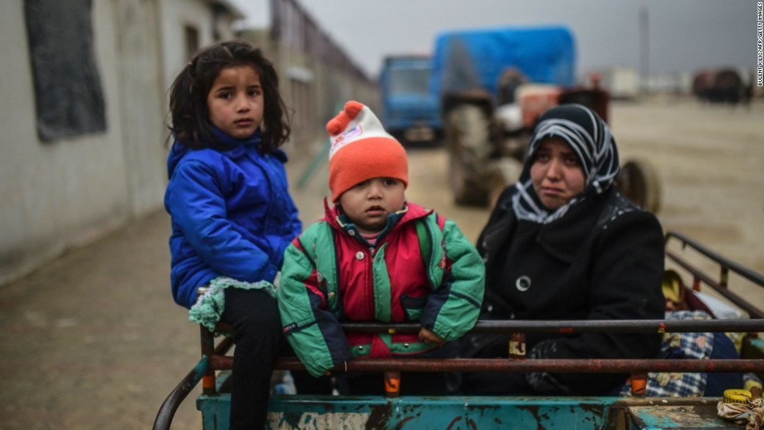 Refugee children arrive at the Turkish border gate on February 6.