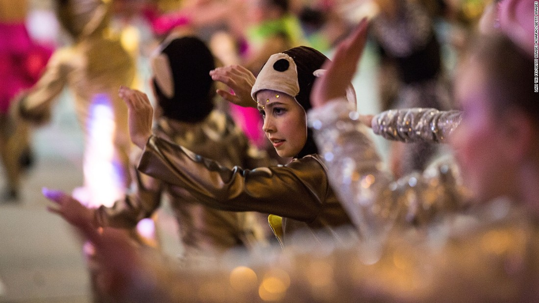 Performers participate in a parade in Hong Kong on February 8.
