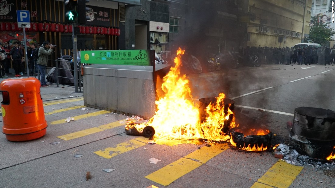 Fires were lit in trash bins as protesters faced off with riot police.