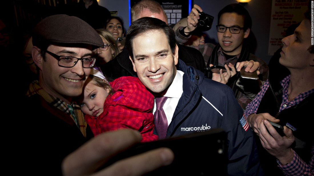 U.S. Sen. Marco Rubio, a Republican presidential candidate, poses for a selfie during a campaign stop in Goffstown, New Hampshire, on Monday, February 8.
