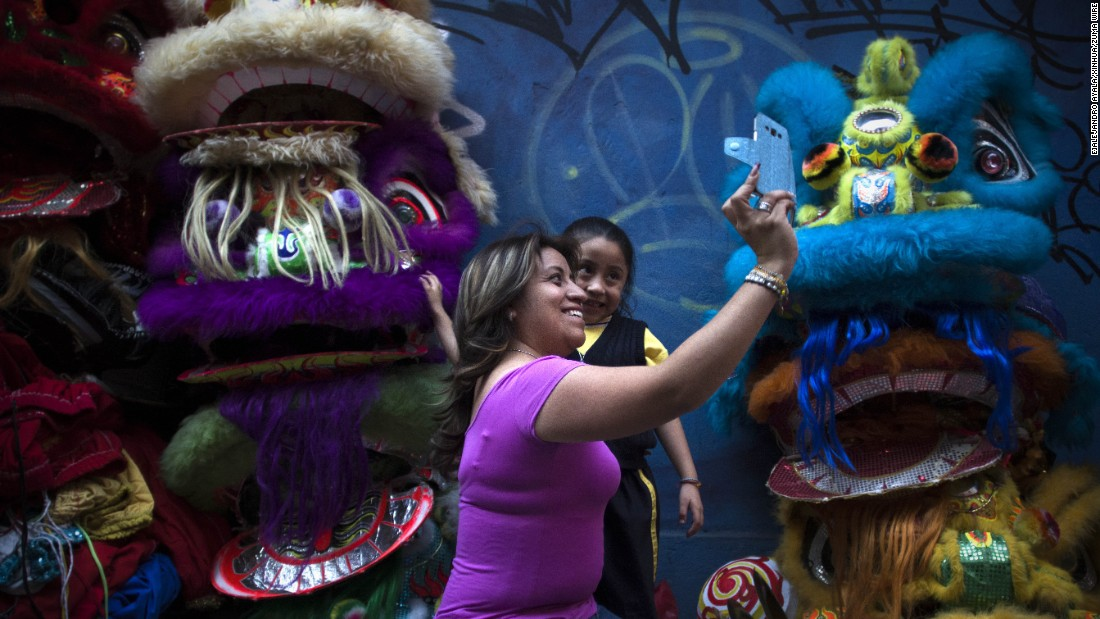 "People take a selfie in Mexico City's Chinatown area on Friday, February 5, ahead of the <a href=""http://www.cnn.com/2016/01/31/world/gallery/year-of-the-monkey-lunar-new-year/index.html"" target=""_blank"">Lunar New Year</a> holiday."