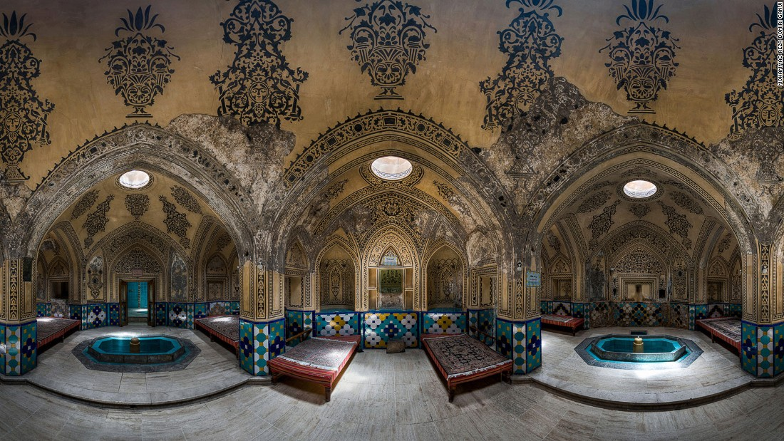 """To photograph this bath I went there several times and sat on its couches for hours,"" says Ganji. ""I tried to choose a time when artificial lights were off and the only source of illumination was the light from holes in the ceiling."""