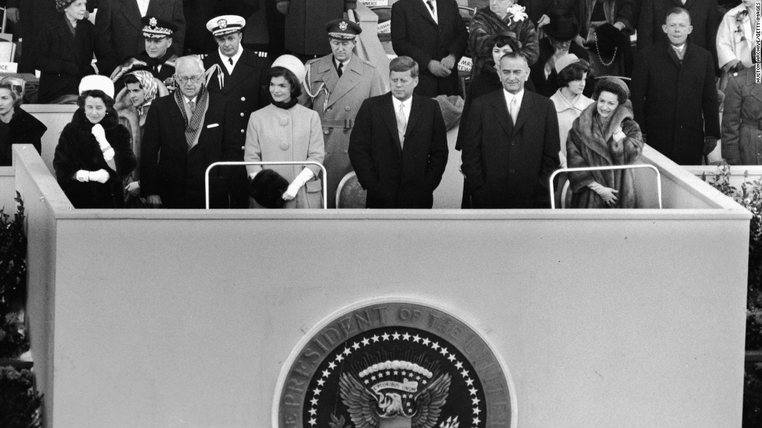 "Kennedy and his wife stand at the 1960 inauguration with his parents on the left. Vice President Lyndon B. Johnson and his wife, Lady Bird, are on the right. During his inaugural speech, Kennedy spoke these memorable words: ""Ask not what your country can do for you, ask what you can do for your country."""