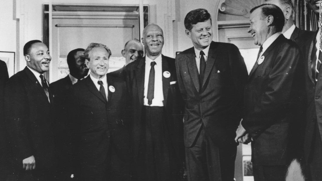 "Kennedy deemed civil rights a ""moral issue"" in June 1963, stating that America ""will not be fully free until all its citizens are free."" Here, he stands with civil rights leaders who organized the 1963 March on Washington, including Martin Luther King Jr. on the far left."