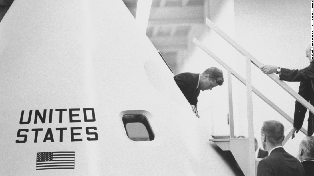 In May 1961, Kennedy urged Congress to send a man to the moon by the end of the decade. Here, he emerges from inside a model of the Apollo space capsule during a tour of the Manned Space Center -- now the Lyndon B. Johnson Space Center -- in Houston.