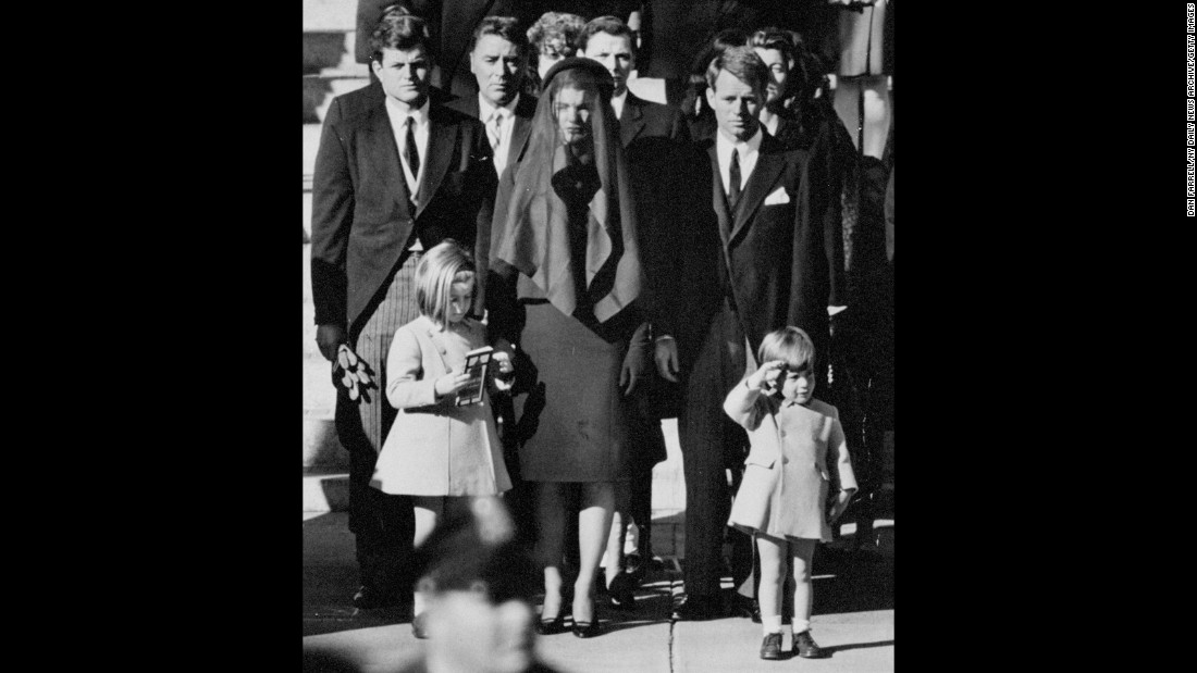 John F. Kennedy Jr., age 3, salutes his father's flag-draped casket in this iconic image taken at the President's funeral procession in Washington.