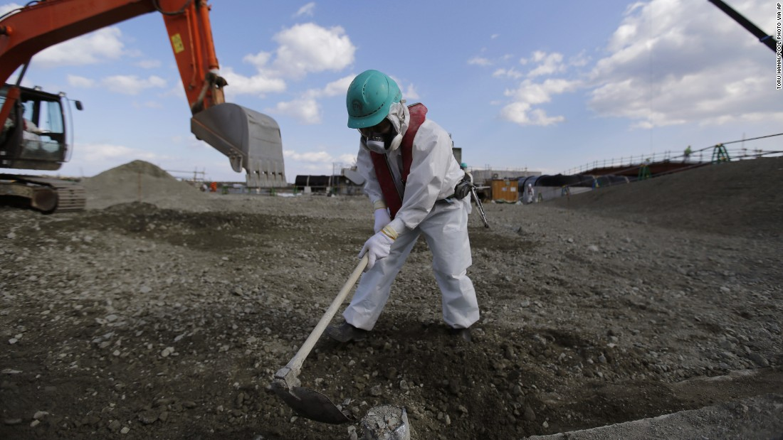 A worker levels out the ground at the Fukushima Daiichi nuclear plant on February 10.