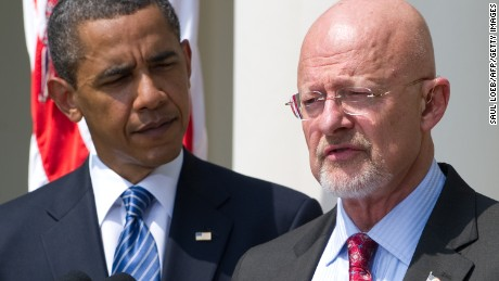US President Barack Obama stands alongside retired General James Clapper, Obama's nominee for director of national intelligence, in the Rose Garden of the White House in Washington, DC, June 5, 2010.