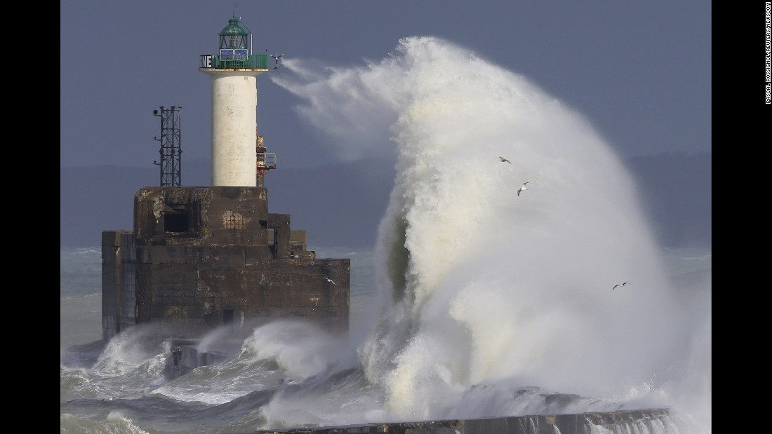 Waves crash against a lighthouse during heavy winds in Boulogne-sur-Mer, France, on Sunday, February 7.