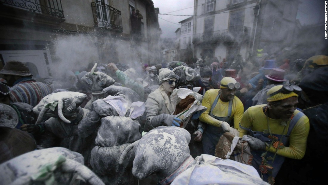 "Revelers participate in a flour fight during ""O Entroido,"" a weeklong festival in Laza, Spain, on Monday, February 8."