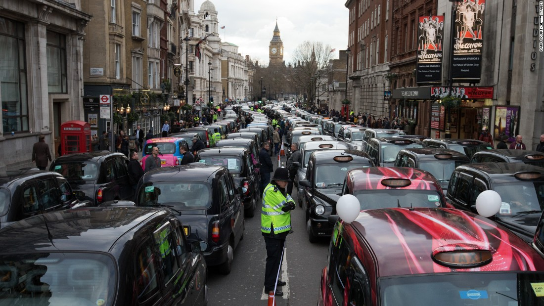 Cab drivers block a street in London as they protest the Uber car service on Wednesday, February 10.