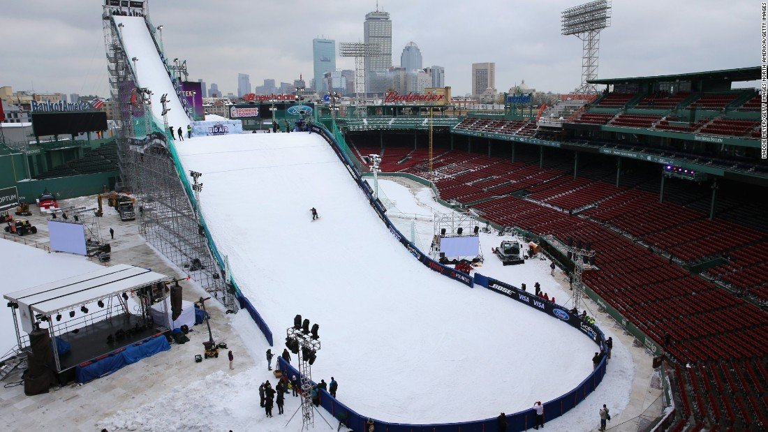 A snowboarder makes a practice run down the ski and snowboarding ramp at Fenway Park, Boston, ahead of the Big Air at Fenway event.