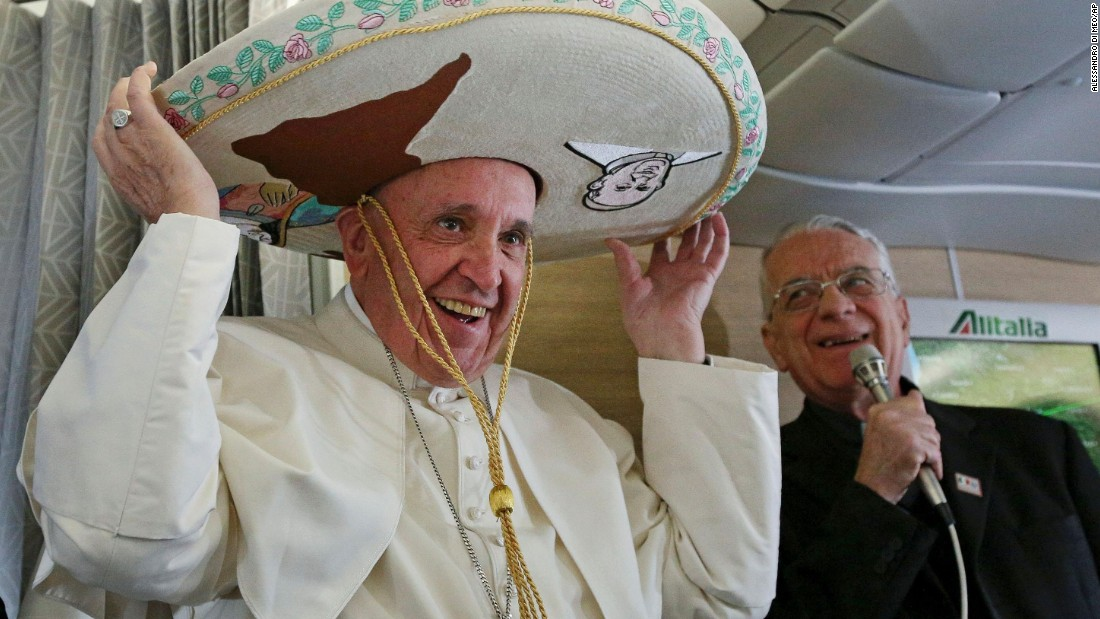 Pope Francis tries on a traditional sombrero he received as a gift from a Mexican journalist on Friday, February 12, 2016, aboard a flight from Rome to Havana, Cuba. The voyage kicked off his weeklong trip to Mexico. With his penchant for crowd-pleasing and spontaneous acts of compassion, Pope Francis has earned high praise from fellow Catholics and others since he succeeded Pope Benedict XVI in March 2013.