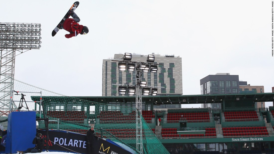 Snowboarder Angus Waddington of Australia competes in the second heat during day one of Big Air at Fenway.