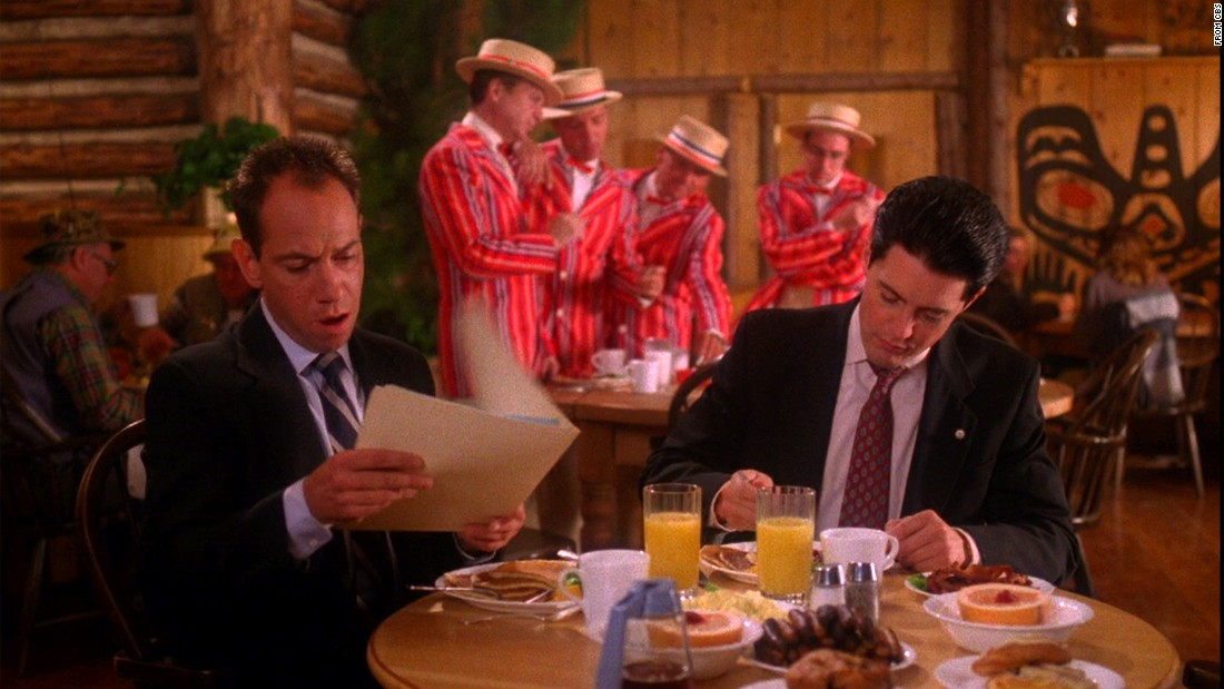 "A barbershop quartet creates a surreal scene in a 1990 episode of ""Twin Peaks,"" humming softly in the background while FBI Agent Dale Cooper (Kyle MacLachlan) discusses zen and the art of solving murder mysteries over breakfast with a colleague (Miguel Ferrer)."