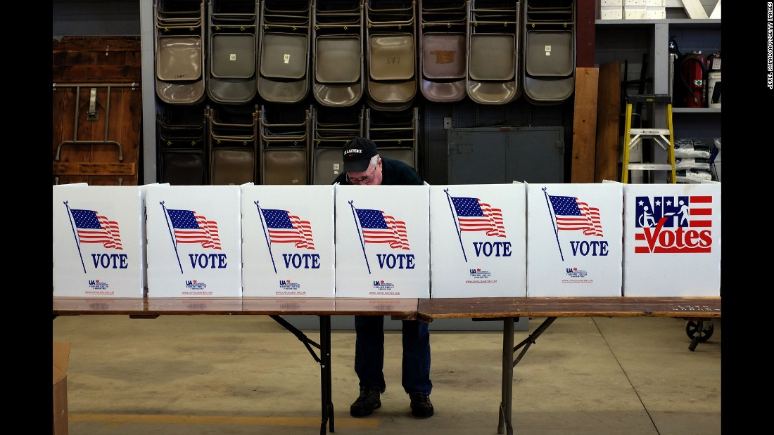 A man in Loudon, New Hampshire, votes in the state's presidential primary on Tuesday, February 9.