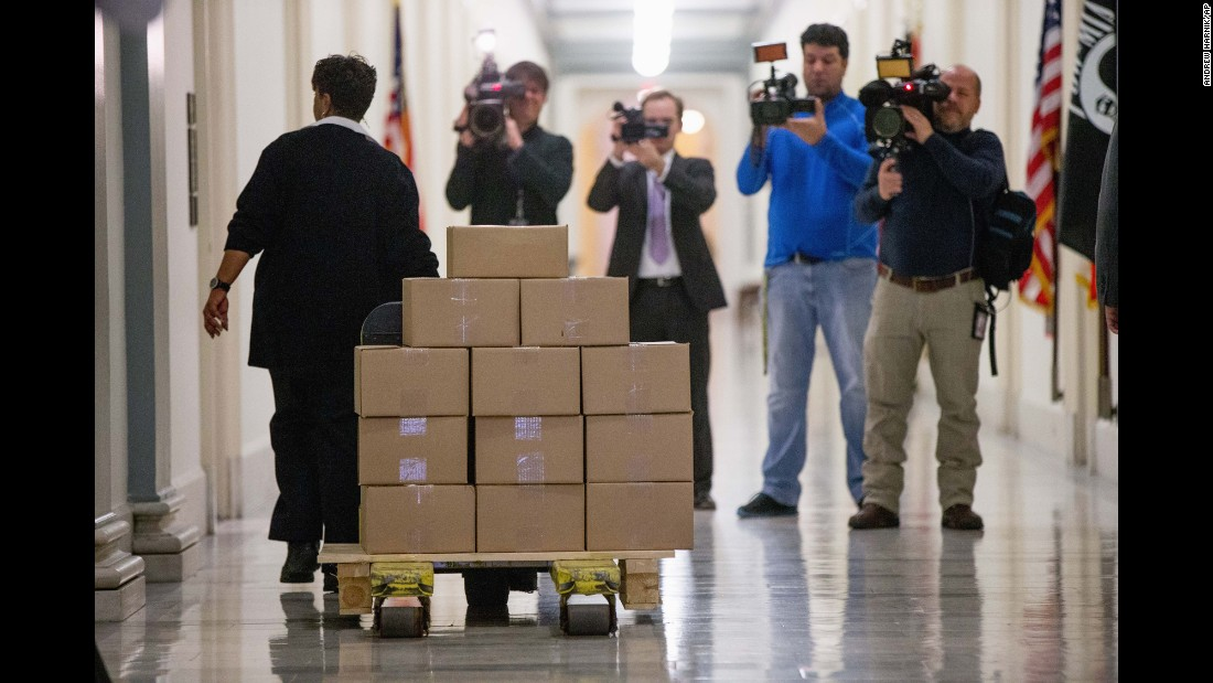 "A staff member delivers President Barack Obama's final budget proposal to the House Budget Committee Room on Tuesday, February 9. The annual budget plan -- nearly always deemed ""dead on arrival"" to the Republican-controlled Congress -- <a href=""http://www.cnn.com/2016/02/09/politics/obama-budget-republicans/"" target=""_blank"">appeared particularly lifeless this year:</a> Republicans said before the document even arrived that they would break the long precedent of hearing from the President's budget chief as they draft their own fiscal blueprint."