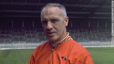 Former Liverpool manager Bill Shankly poses before the famous Spion Kop at Anfield.
