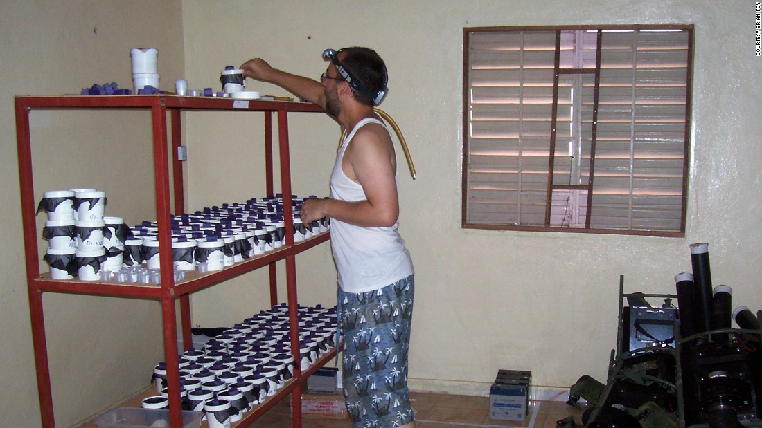 Kevin Kobylinski adds sugar water to collected mosquitoes. The research team compared the life span of mosquitoes from Ibel, where villagers where taking ivermectin, to mosquitoes collected from Ndebou, where villagers where not on the medication.