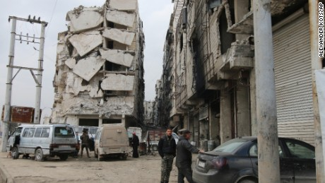 In this Thursday, Feb. 11, 2016 photo, a building is seen with heavy damage in Aleppo, Syria. The fighting around Syria's largest city of Aleppo has brought government forces closer to the Turkish border than at any point in recent years, routing rebels from key areas and creating a humanitarian disaster as tens of thousands of people flee. (Alexander Kots/Komsomolskaya Pravda via AP)