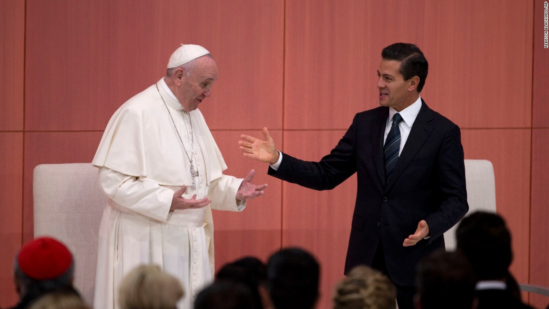 Pope Francis laughs with Mexican President Enrique Pena Nieto during a welcome ceremony at the National Palace.
