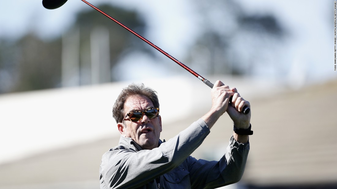 Musician Huey Lewis, of Huey Lewis and the News fame, tees off  at the Pebble Beach National Pro-Am.