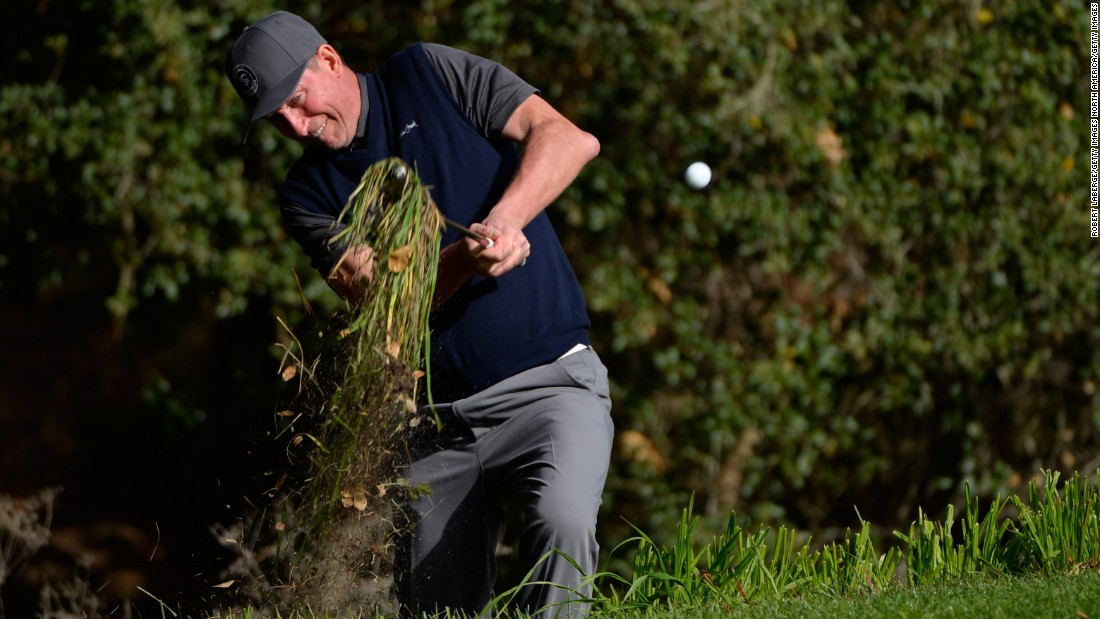 This man is usually quite useful with a stick in his hand. Canadian ice-hockey legend Wayne Gretzky takes a chunk of the rough at the 16th hole at the Spyglass Hill course during the Pebble Beach National Pro-Am.