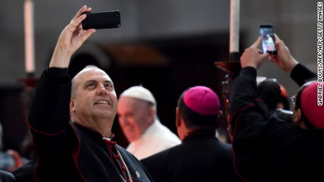 "Mexican bishops take snapshots as Pope Francis arrives for a meeting with the Bishops of Mexico gathered in the Cathedral in Mexico on February 13, 2016. Pope Francis called on Mexico's leaders Saturday to provide ""true justice"" and security to citizens hit by drug violence as he addressed a National Palace packed with politicians.   AFP PHOTO / GABRIEL BOUYS / AFP / GABRIEL BOUYS        (Photo credit should read GABRIEL BOUYS/AFP/Getty Images)"