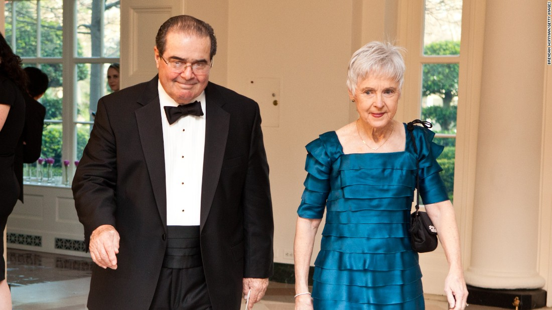 Scalia and  his wife, Maureen, arrive for a state dinner in honor of British Prime Minister David Cameron at the White House on March 14, 2012, in Washington.
