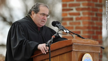 US Supreme Court Associate Justice Antonin Scalia conducts a naturalization ceremony for sixteen new US citizens during the commemoration of the 150th anniversary of US President Abraham Lincolns historic Gettysburg Address on November 19, 2013 at Gettysburg National Military Park in Gettysburg, Pennsylvania. AFP  PHOTO/Mandel NGAN        (Photo credit should read MANDEL NGAN/AFP/Getty Images)